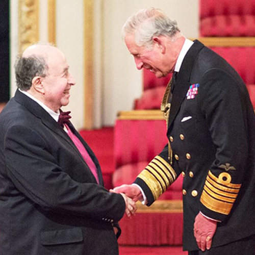 Ernest Hecht receives his OBE for services to publishing from HRH Prince Charles